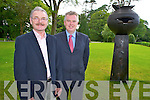 Pat Dawson, Regional Manager NPW, pictured with woodturner Liam O'Neill at the launch of the exhibition of outdoor wood sculptures in Muckross Gardens, Killarney on Thursday.