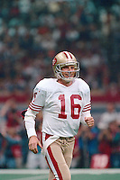 NEW ORLEANS, LA - Quarterback Joe Montana of the San Francisco 49ers smiles during Super Bowl XXIV against the Denver Broncos at the Superdome in New Orleans, Louisiana in January of 1990. Photo by Brad Mangin.