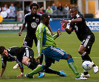 Jhon Kennedy Hurtado (c) of the Seattle Sounders fights for the ball with Chris Pontius (l), Clyde Simms (2nd l) and Rodney Wallace (r) of DC United in the match played on June 17, 2009 at Quest Field in Seattle, WA. The Sounders and United played to a 3-3 draw.