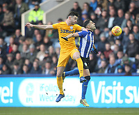 Preston North End's Andrew Hughes  jumps with Sheffield Wednesday's Marco Matias <br /> <br /> Photographer Mick Walker/CameraSport<br /> <br /> The EFL Sky Bet Championship - Sheffield Wednesday v Preston North End - Saturday 22nd December 2018 - Hillsborough - Sheffield<br /> <br /> World Copyright &copy; 2018 CameraSport. All rights reserved. 43 Linden Ave. Countesthorpe. Leicester. England. LE8 5PG - Tel: +44 (0) 116 277 4147 - admin@camerasport.com - www.camerasport.com