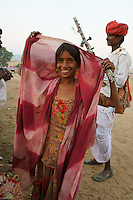 girl and musician  Bapuram at camel fair in holy city Pushkar while sunset time
