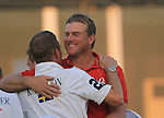 Robert Karlsson hugs his caddy after winning the Dubai World Championship on the 2nd playoff hole at the 18th hole during the Final Day of the Dubai World Championship, Earth Course, Jumeirah Golf Estates, Dubai, 28th November 2010..(Picture Eoin Clarke/www.golffile.ie)