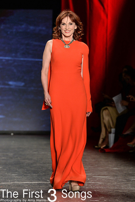 Marilu Henner walks the runway during the American Heart Association's Go Red For Women Fashion Show at the Mercedes-Benz Fashion Week Fall 2016 in New York City.