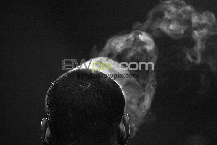 PICTURE BY VAUGHN RIDLEY/SWPIX.COM - Rugby League - Preseason Friendly - Castleford Tigers v Huddersfield Giants - Probiz Coliseum, Castleford, England - 14/01/12 - Steam rises from Huddersfield's Leroy Cudjoe's head in the cold weather.