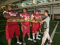 Hawgs Illustrated /BEN GOFF @NWABENGOFF<br /> Andy Shupe, NWA Democrat-Gazette photojournalist, sets up a photo with members of the Arkansas offensive line Saturday, Aug. 5, 2017, during Arkansas football media day at the Fred W. Smith Football Center in Fayetteville.