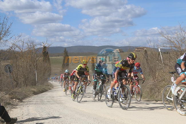 The peloton including Belgian National Champion Yves Lampaert (BEL) Deceuninck-Quick Step and Daniel Oss (ITA) Bora-Hansgrohe on sector 2 Bagnaia during Strade Bianche 2019 running 184km from Siena to Siena, held over the white gravel roads of Tuscany, Italy. 9th March 2019.<br /> Picture: Seamus Yore   Cyclefile<br /> <br /> <br /> All photos usage must carry mandatory copyright credit (© Cyclefile   Seamus Yore)