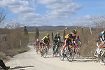 The peloton including Belgian National Champion Yves Lampaert (BEL) Deceuninck-Quick Step and Daniel Oss (ITA) Bora-Hansgrohe on sector 2 Bagnaia during Strade Bianche 2019 running 184km from Siena to Siena, held over the white gravel roads of Tuscany, Italy. 9th March 2019.<br /> Picture: Seamus Yore | Cyclefile<br /> <br /> <br /> All photos usage must carry mandatory copyright credit (© Cyclefile | Seamus Yore)