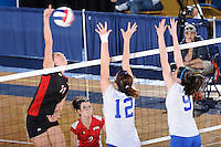 22 November 2008:  Western Kentucky University middle hitter Megan Argabright (11) hits a kill shot during the WKU 3-0 victory over New Orleans in the championship game of the Sun Belt Conference tournament at U.S. Century Bank Arena in Miami, Florida.