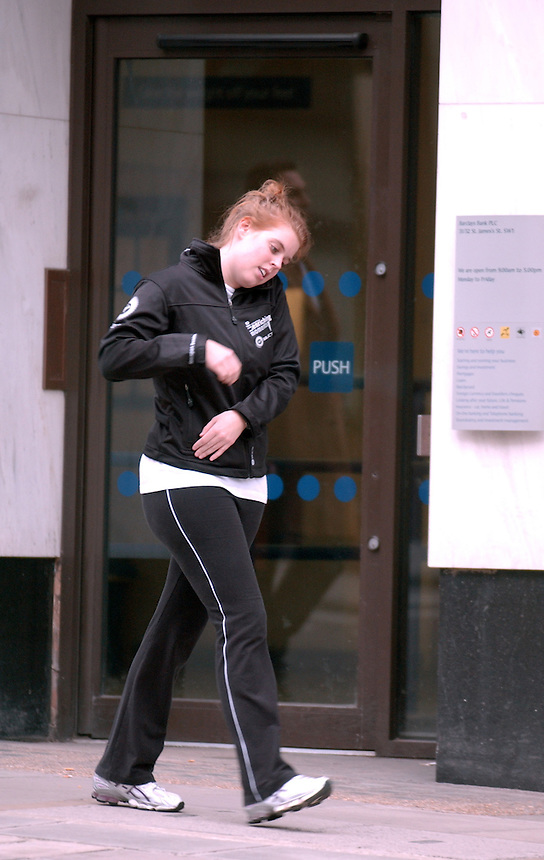 PRINCESS Beatrice of York stops at an ATM in Barclays Bank while chatting on the phone IN ST JAMES PLACE FOLLOWING A WORKOUT WITH A PERSONAL TRAINER IN GREEN PARK. . PIC JAYNE RUSSELL.30.3.09..