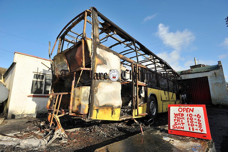 A view of the burned out bus at Enistymon road, Miltown malbay. Photograph by John Kelly.