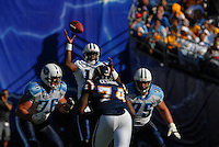 Sept. 17, 2006; San Diego, CA, USA; Tennessee Titans quarterback (10) Vince Young bobbles a snap against the San Diego Chargers at Qualcomm Stadium in San Diego, CA. Mandatory Credit: Mark J. Rebilas