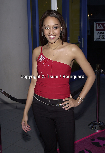 "Tia Mowry - Sister Sister -  arriving at the premiere of "" Josie and the PussyCats"" at the Galaxie Theatre in Los Angeles  4/9/2001  © Tsuni          -            MowryTia02.jpg"