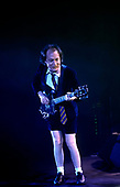 AC/DC - lead guitarist Angus Young performing live at the Apollo Hammersmith, London - 21 Oct 2003 - Photo by: Awais Butt