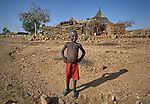 A boy in Kauda, a village in the Nuba Mountains of Sudan. The area is controlled by the Sudan People's Liberation Movement-North, and frequently attacked by the military of Sudan. The Catholic Church sponsors schools and health care facilities throughout the war-torn region.