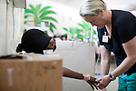 Project HOPE volunteer nurse Joyce Barkin treats a patient in the Emergency Department at the Hospital Albert Schweitzer on Friday, October 29, 2010 in Deschapelles, Haiti.