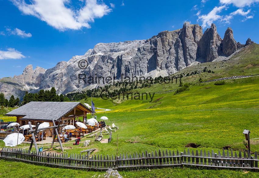 Italy, South Tyrol (Trentino - Alto Adige), Dolomites, near Selva di Val Gardena: alpine pasture hut 'La Malga Sella' with Sella Group at Sella Pass Road   Italien, Suedtirol (Trentino - Alto Adige), oberhalb von Wolkenstein in Groeden: bewirtschaftete Almhuette Malga Sella Alm vor der Sellagruppe an der Sella-Joch-Passstrasse