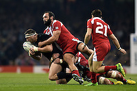 Wyatt Crockett of New Zealand is tackled to ground. Rugby World Cup Pool C match between New Zealand and Georgia on October 2, 2015 at the Millennium Stadium in Cardiff, Wales. Photo by: Patrick Khachfe / Onside Images