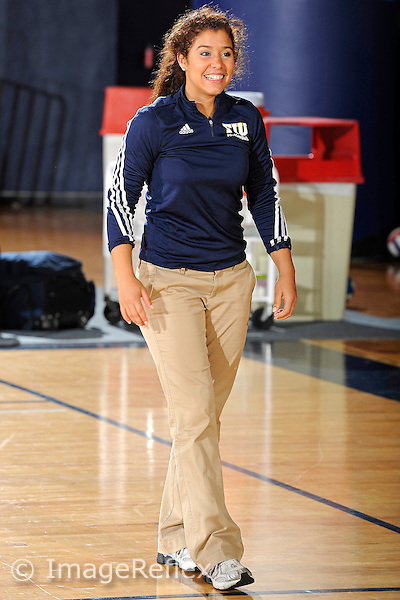 11 September 2011:  FIU Student Assistant Coach Natalia Valentin encourages players prior to the match.  The FIU Golden Panthers defeated the Florida A&M University Rattlers, 3-0 (25-10, 25-23, 26-24), at U.S Century Bank Arena in Miami, Florida.
