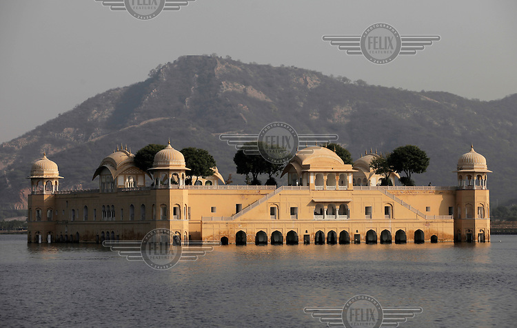 "Jal Mahal (meaning ""Water Palace"") is a palace located in the middle of the Man Sagar Lake in Jaipur city, the capital of the state of Rajasthan, India. The palace and the lake around it were renovated and enlarged in the 18th century by Maharaja Jai Singh II of Amber...The urban lake gets filled up during the rainy season; over the years, once the reservoir became full during rainy season, it got covered with Hyacinth. During this period the red stoned palace became approachable only by boat and through a causeway, and presented a spectacle on the way to Jaipur city from Delhi."