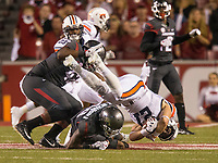 Hawgs Illustrated/BEN GOFF <br /> Kevin Richardson, Arkansas defensive back, trips up Chandler Cox, Auburn half back, as Jonathan Marshall, Arkansas defensive end, assists on the tackle in the first quarter Saturday, Oct. 21, 2017, at Reynolds Razorbacks Stadium in Fayetteville.