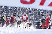 Sunday February 27, 2010   Jeremiah Klejka leaves the start line of the Junior Iditarod at Willow Lake , Alaska