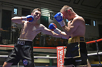 Dan Morley (black shorts) defeats Lee Hallett during a Boxing Show at York Hall on 30th June 2018