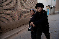 Young Uighur boys play with toy guns in the Old City section of Kashgar, Xinjiang, China.