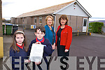3rd Class students Paddy Falvey and Kaley Killeen with the letter from Ruairi Quinn TD Minister for Education, hoping the new school promised will be soon after the storm damage last week here with Mary Dillan, Deputy Principal,  Annette Dinneen, Principal on Wednesday