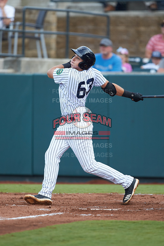 Chad Bell (63) of the Pulaski Yankees follows through on his swing against the Danville Braves at Calfee Park on June 30, 2019 in Pulaski, Virginia. The Braves defeated the Yankees 8-5 in 10 innings.  (Brian Westerholt/Four Seam Images)