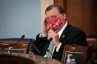 United States Representative Tom Cole (Republican of Oklahoma), ranking member, US House Appropriations Subcommittee on Labor, Health and Human Services, Education, and Related Agencies, puts on a face covering during a hearing on Capitol Hill in Washington, D.C., U.S., on Thursday, June 4, 2020. <br /> Credit: Al Drago / Pool via CNP/AdMedia
