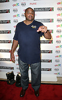CHARLES BARKLEY.The Ante Up for Africa Celebrity Poker Tournament at the Rio Resort Hotel and Casino, Las Vegas, Nevada, USA..July 2nd, 2009.full length jeans denim blue top hand pointing .CAP/ADM/MJT.© MJT/AdMedia/Capital Pictures