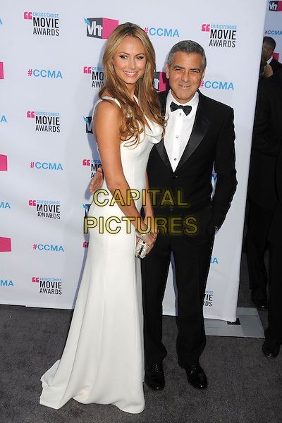 Stacy Keibler and George Clooney.17th Annual Critics Choice Movie Awards - Arrivals held at the Hollywood Palladium,  Los Angeles, California, USA, 12th January 2012..arrivals full length black white dress long maxi black tuxedo tux bow tie arm around couple .CAP/ADM/BP.©Byron Purvis/AdMedia/Capital Pictures.