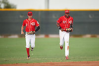 AZL Reds outfielders Rafael Franco (2) and Fidel Castro (17) jog off the field between innings of an Arizona League game against the AZL Athletics Green on July 21, 2019 at the Cincinnati Reds Spring Training Complex in Goodyear, Arizona. The AZL Reds defeated the AZL Athletics Green 8-6. (Zachary Lucy/Four Seam Images)