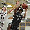Victor Olawoye #2 of Elmont looks to drive to the net as Matt Granville #11 of Garden City contests his shot during a Nassau County A-1 varsity boys basketball game at Garden City High School on Wednesday, Jan. 10, 2018. After leading by 26 points in the third quarter, Garden City survived an Elmont rally and won by a final score of 47-43.