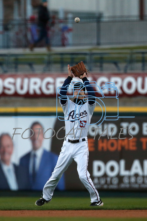 Reno Aces' Kelby Tomlinson makes a play against the Albuquerque Isotopes during their home opener in Reno, Nev., on Tuesday, April 9, 2019.  The Aces won 4-2. <br /> Photo by Cathleen Allison/Nevada Momentum
