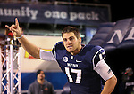 Nevada's Cody Fajardo runs on the field before an NCAA college football game against Fresno State in Reno, Nev., on Saturday, Nov. 22, 2014. Fresno State won 40-20. (AP Photo/Cathleen Allison)