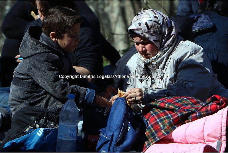 Pictured: Stranded migrants at Tempe Thursday 25 February 2016<br /> Re: Hundreds of migrants, including families with young children, that were stranded at Tempe in central Greece, were forced to walk on foot on the motorway to reach Idomen, about 168 kilometres away, in the northern part of the country, at the Greek FYRO Macedonian border. Local police were at first escorting them, then made sure that they were safely transported on coaches.