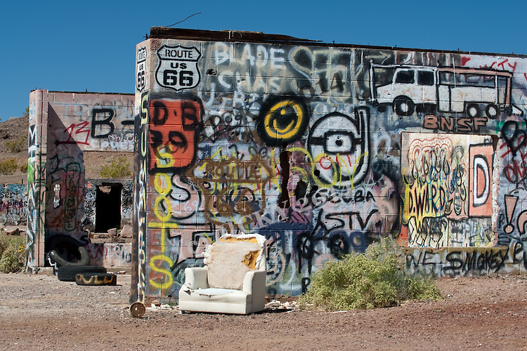 Graffiti covered remains of a long gone cafe and gas station along Route 66