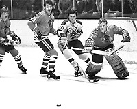 Seals vs Blackhawks..1970..Billy Hicke, Hawks #3Keith Magnuson,#14 Bryan Campbell and goalie Ken Brown. (photo/Ron Riesterer)
