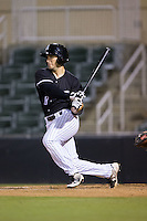 Kyle Ruchim (8) of the Kannapolis Intimidators follows through on his swing against the Greenville Drive at Intimidators Stadium on June 7, 2016 in Kannapolis, North Carolina.  The Drive defeated the Intimidators 5-2 in game two of a double header.  (Brian Westerholt/Four Seam Images)