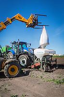 Loading base fertilser into front mounted hopper - Suffolk, April