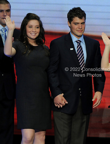 St. Paul, MN - September 3, 2008 -- Bristol Palin, 17, waves from the podium as she holds the hand of her boyfriend Levi Johnston arrive on the podium after Governor Sarah Palin's acceptance speech on day 3 of the 2008 Republican National Convention at the Xcel Energy Center in Saint Paul, Minnesota on Wednesday, September 3, 2008.Credit: Ron Sachs / CNP.(RESTRICTION: NO New York or New Jersey Newspapers or newspapers within a 75 mile radius of New York City)