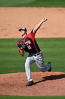 Tampa Spartans pitcher Michael Calkins (11) delivers a pitch during an exhibition game against the Philadelphia Phillies on March 1, 2015 at Bright House Field in Clearwater, Florida.  Tampa defeated Philadelphia 6-2.  (Mike Janes/Four Seam Images)