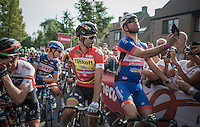 an amateur rider sneaked in on the start grid front row &amp; did the only other thing left to do: take a selfie with World Champion Peter Sagan (SVK/Tinkoff)<br /> <br /> 12th Eneco Tour 2016 (UCI World Tour)<br /> stage 4: Aalter - St-Pieters-Leeuw (202km)