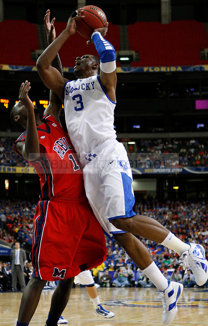 ATLANTA, GA. - Terrence Jones takes a shot over Terrance Henry during the second round of the 2011 SEC Men's Basketball Tournament between Kentucky and Ole Miss , played at the Georgia Dome, Friday, March 11, 2011.  Kentucky won 75-66. Photo by Latara Appleby | Staff