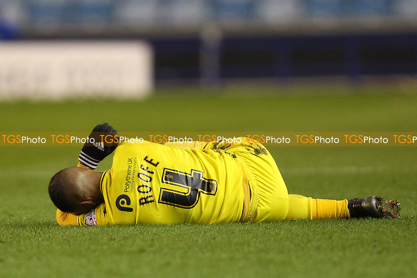 Kemar Roofe of Oxford United goes down with an injury during Millwall vs Oxford United at The Den