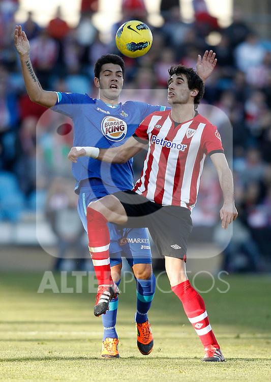 Getafe's Miku against Athletic de Bilbao's Javier Martinez during La Liga Match. January 08, 2012. (ALTERPHOTOS/Alvaro Hernandez)