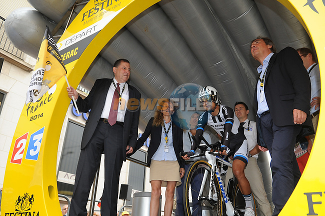 Daniel Garrigue, Mayor of Bergerac, waves the first rider Cheng Ji (CHN) Team Giant-Shimano away from the start ramp of Stage 20 Individual Time Trial of the 2014 Tour de France running 54km from Bergerac to Perigueux. 25th July 2014.<br /> Photo ASO/G.Demouveaux/www.newsfile.ie