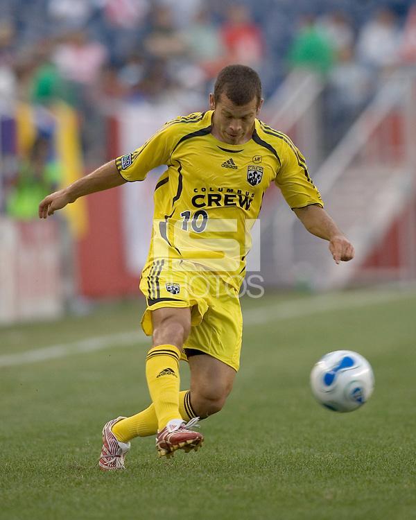 Alejandro Moreno (Columbus Crew, yellow) crosses the ball. New England Revolution tied the Columbus Crew, 3-3, at Gillette Stadium on June 16, 2007.