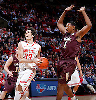 Ohio State Buckeyes guard Amedeo Della Valle (33) is guarded by Louisiana-Monroe Warhawks forward Jayon James (1) during Friday's NCAA Division I basketball game at Value City Arena in Columbus on December 27, 2013. Ohio State led the game at halftime, 41-20. (Barbara J. Perenic/The Columbus Dispatch)